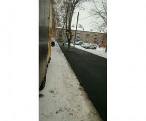 У природы нет плохой погоды: в Башкирии продолжают класть асфальт в дождь и снег